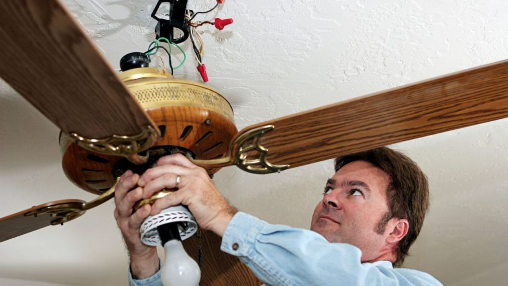 Man removing old ceiling fan