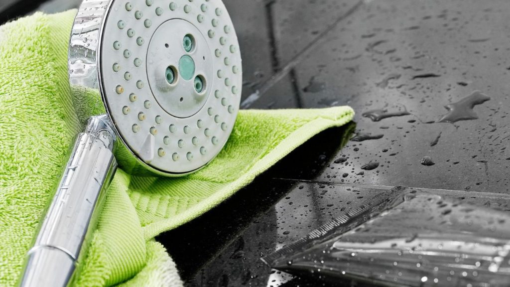 swapping showerheads with a brand-new replacement